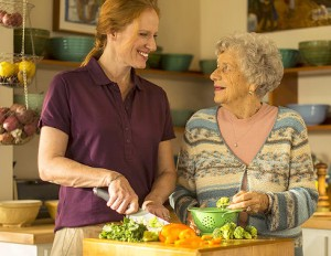 caregiver-cooking-with-senior